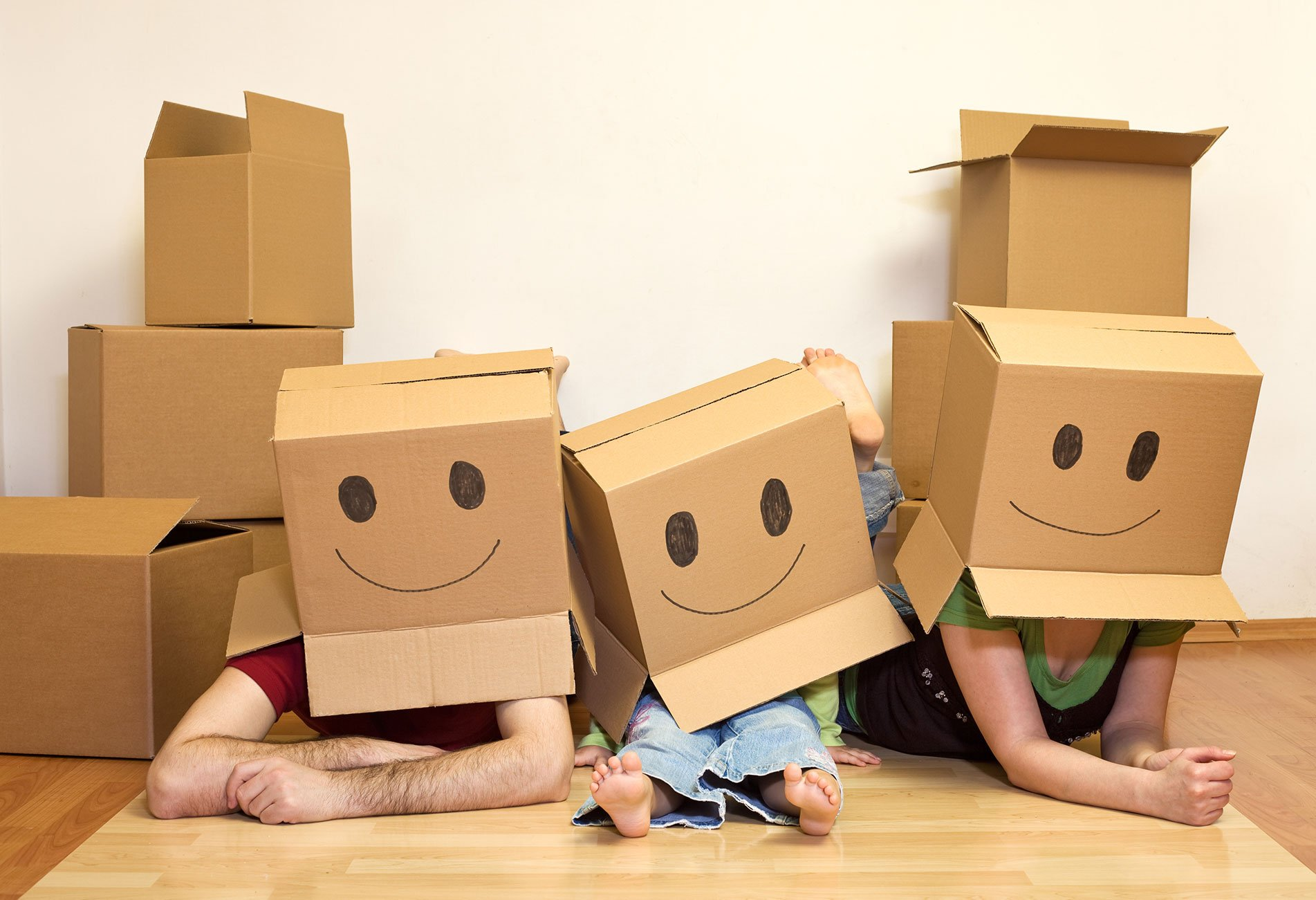happy family playing in carboard boxes
